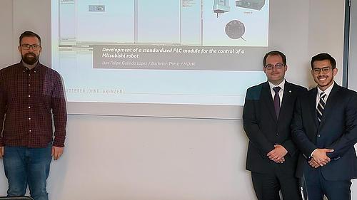 Christian Vogel, Prof. Dr. Alexander Kratzsch und Luis Lopez vor einer Präsentation